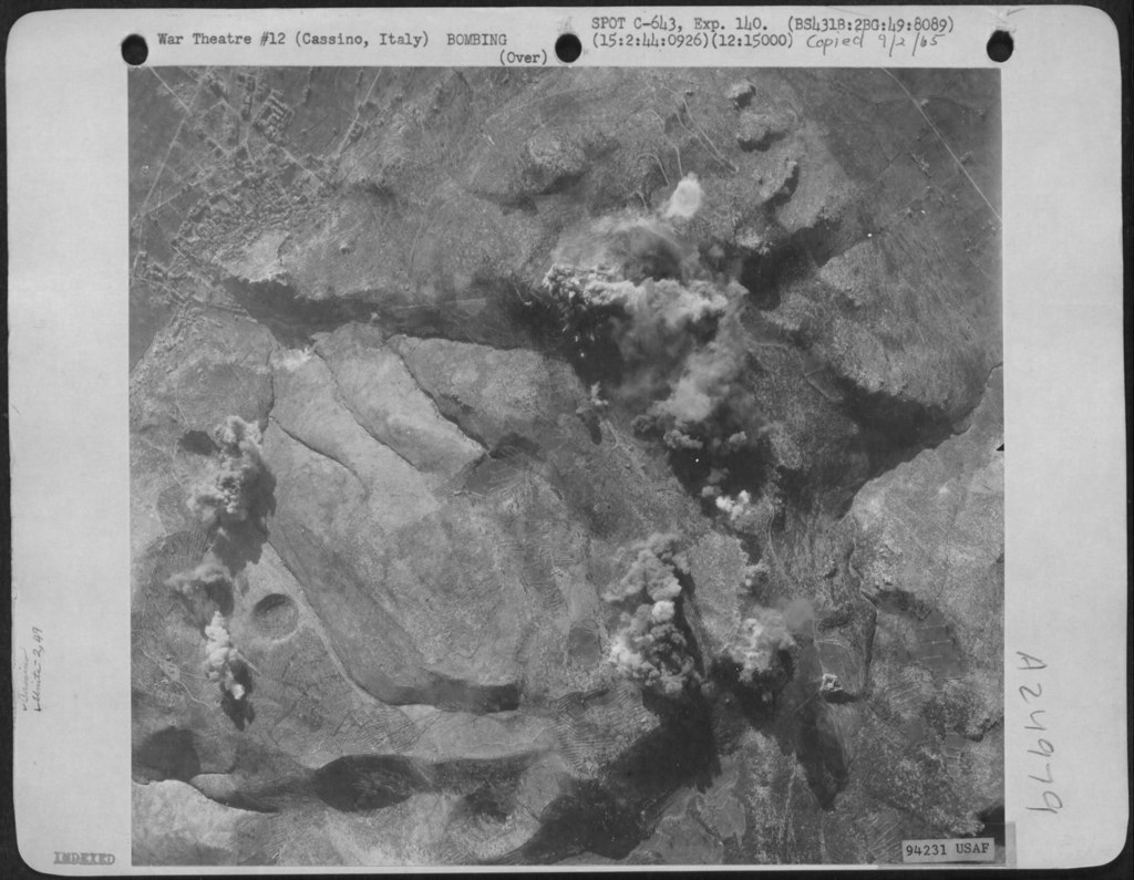 <p class='eng'>Bombs Burst On The Monastery At Cassino, Italy, After Planes Of The 2Nd Bomb Group, 49Th<br /> Bomb Squadron Dropped Their Bombs On 15 February 1944. (http://www.fold3.com/).</p>